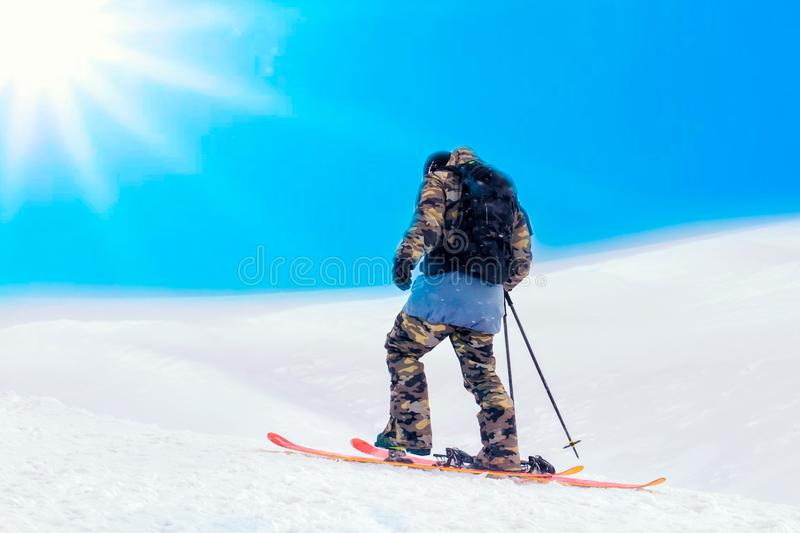 skiing background, skier in beautiful mountain top landscape, winter holidays in Alps. space for text royalty free stock images