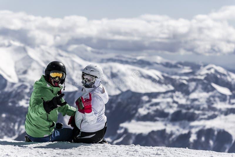 Skiing family enjoying winter vacation royalty free stock images