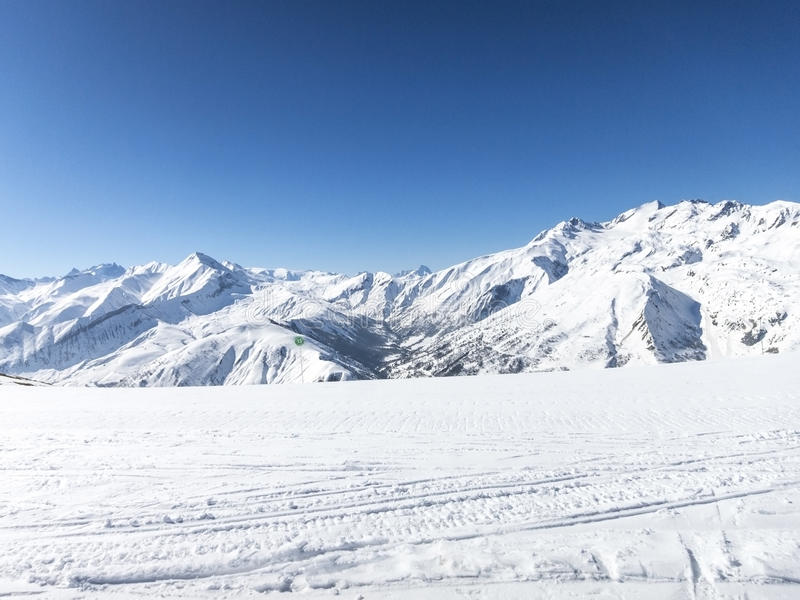 Skiing in French alps. Les Sybelles ski slopes in France royalty free stock photos