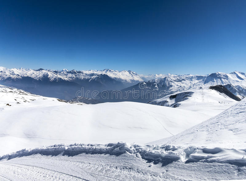 Skiing in French alps with a lot of sun royalty free stock image