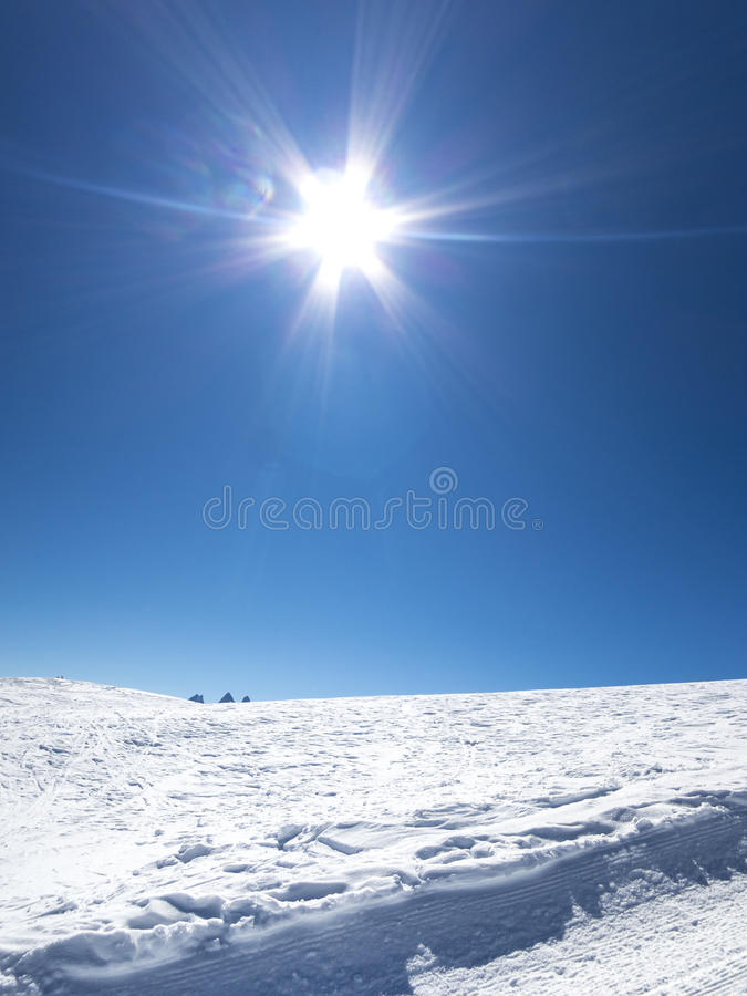Skiing in French alps with a lot of sun. Les Sybelles ski slopes in France royalty free stock photo