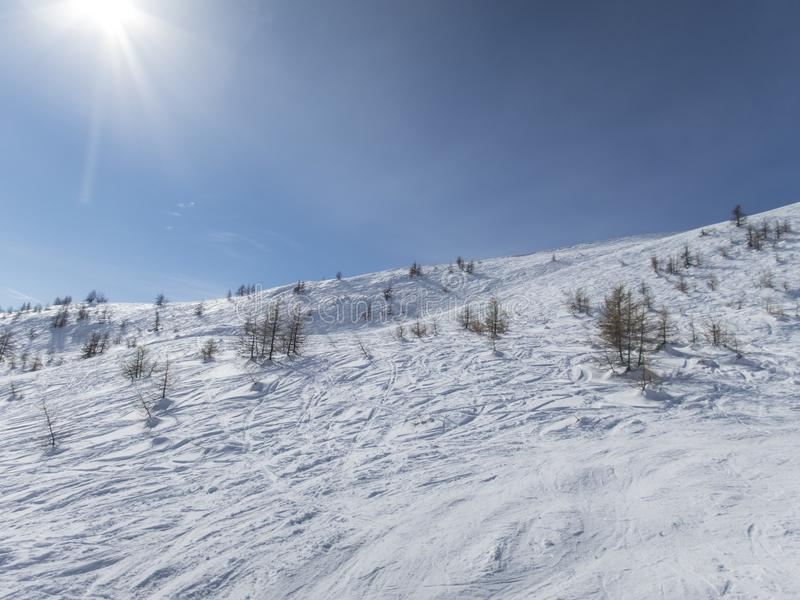 Skiing in the French alps. Ski field in the French alps Puy Saint Vincent royalty free stock photography
