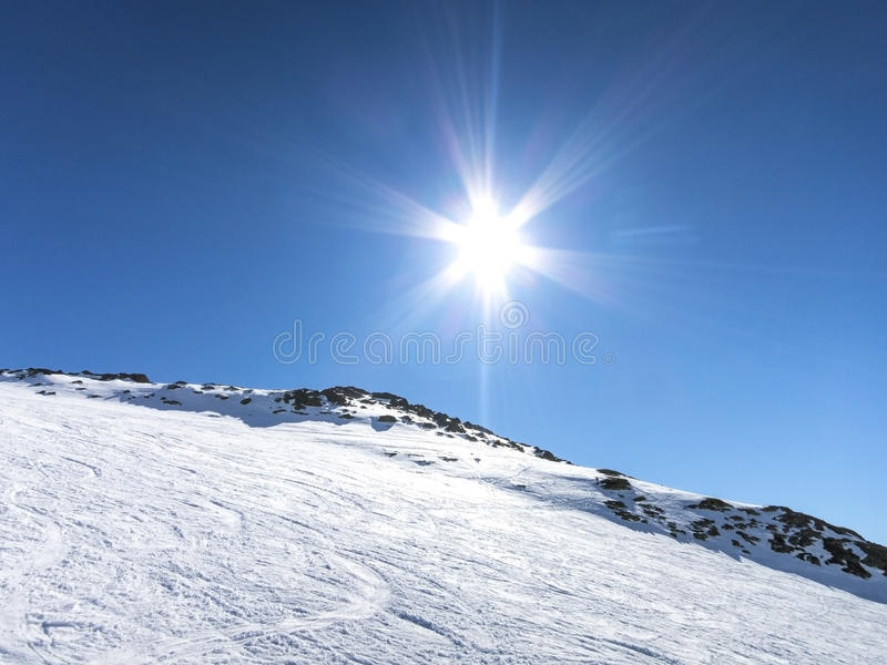 Skiing in French alps with a sun reflection. Les Sybelles ski slopes in France royalty free stock photos