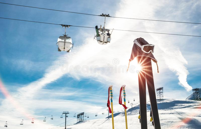Skiing goggles and skis poles at resort glacier with chair lift stock photos