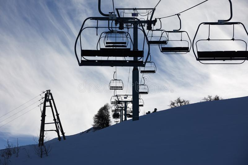 Skiing lift in the ALps. Ski lift in the shadow stock photos