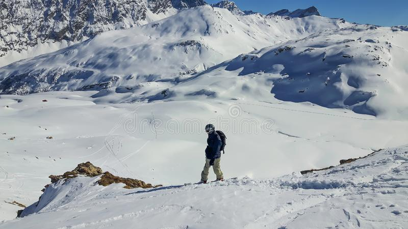 Alps Skiing Snowboarder in Backcountry with backpack royalty free stock photography