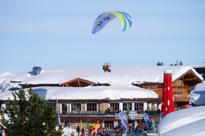 Skiing and paragliding in Penken ski resort at Zillertal Austria royalty free stock image
