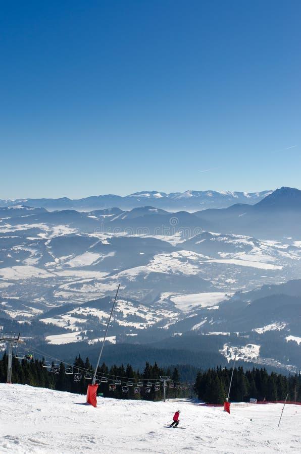 Skiing park Kubinska Hola, Travel destination for winter vacations. Skiing park Kubinska Hola, Orava, Slovakia. Chair lift and view from the ski slopes on snow stock photography