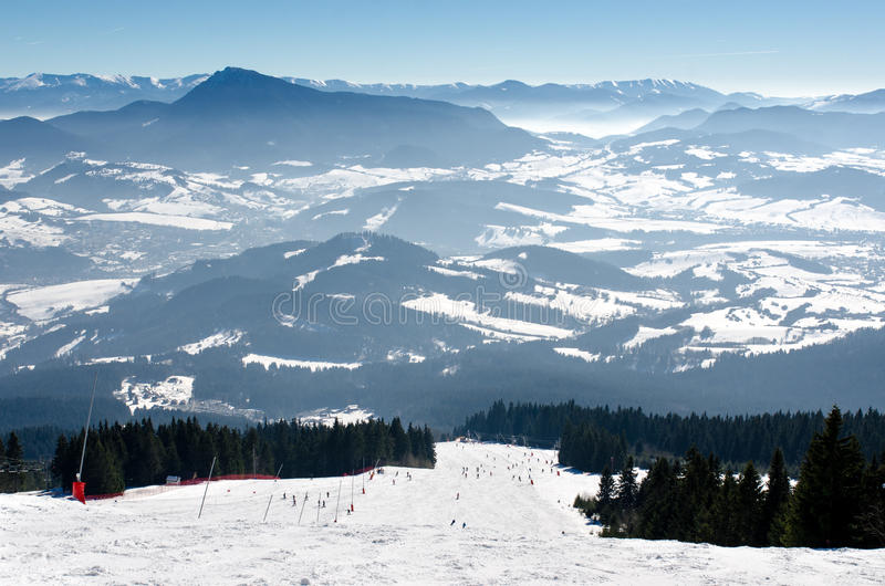Skiing park Kubinska Hola, Travel destination for winter vacations. Skiing park Kubinska Hola, Orava, Slovakia. Chair lift and view from the ski slopes on snow royalty free stock photos