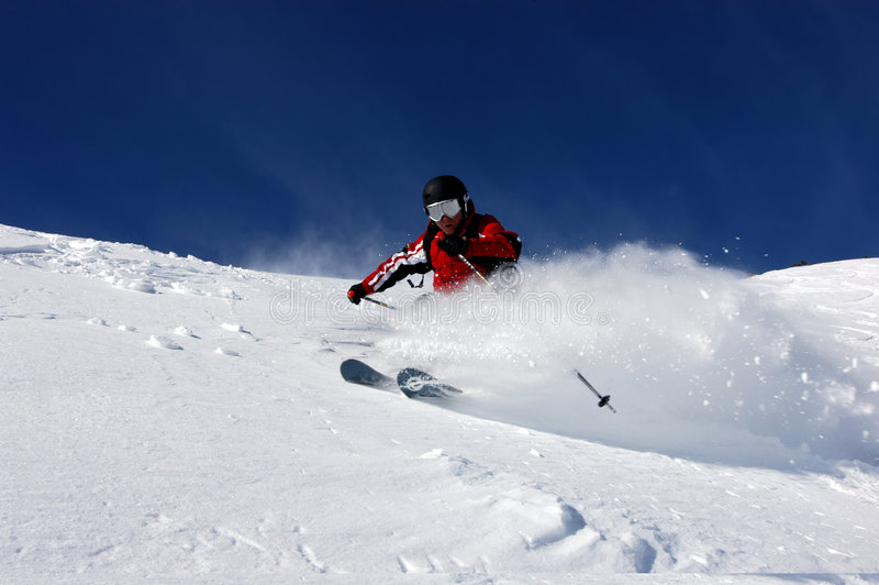 Skiing Powder royalty free stock photography