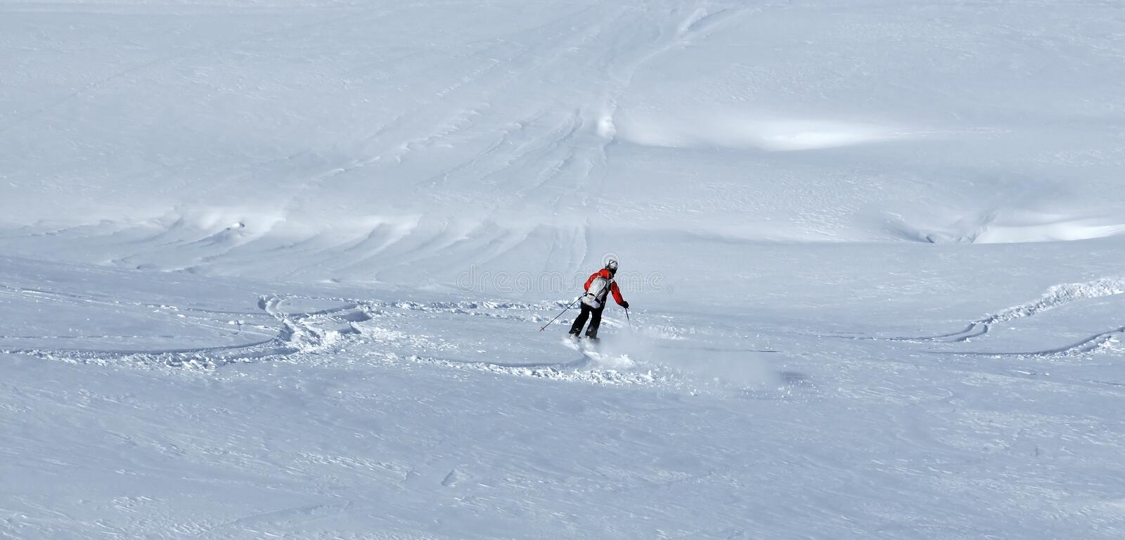 Skiing in powder snow royalty free stock photography