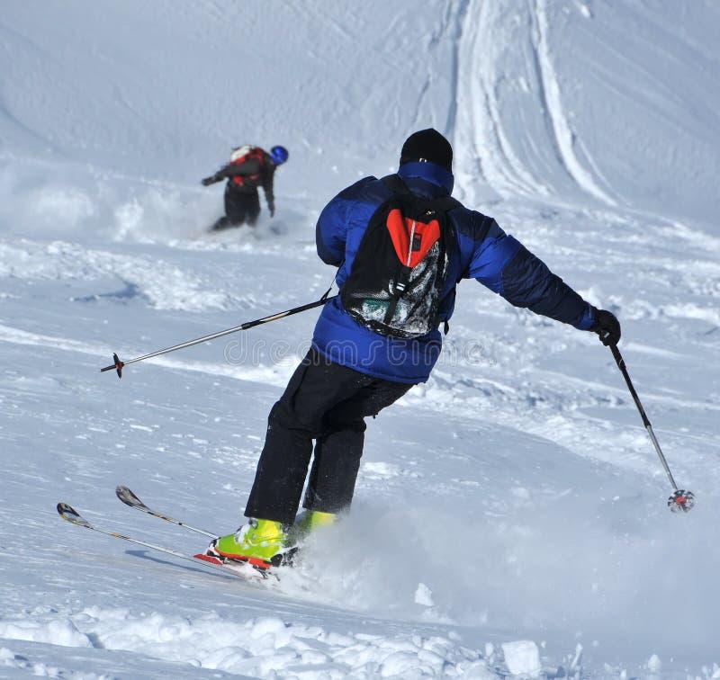 Skiing in powder snow stock photos