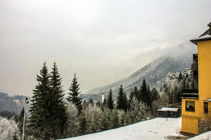 Skiing resort Semmering, Austria. Traditional chalet in austrian Alps in winter. Panoramic view of idyllic winter wonderland mount royalty free stock photography