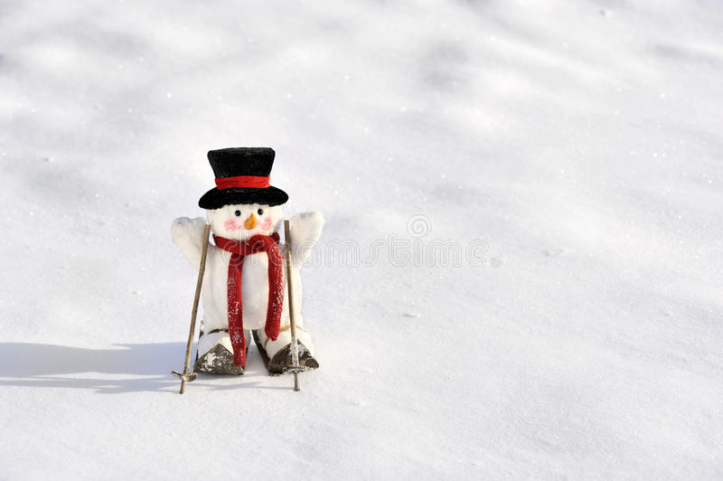 Skiing snowman in winter landscape stock images