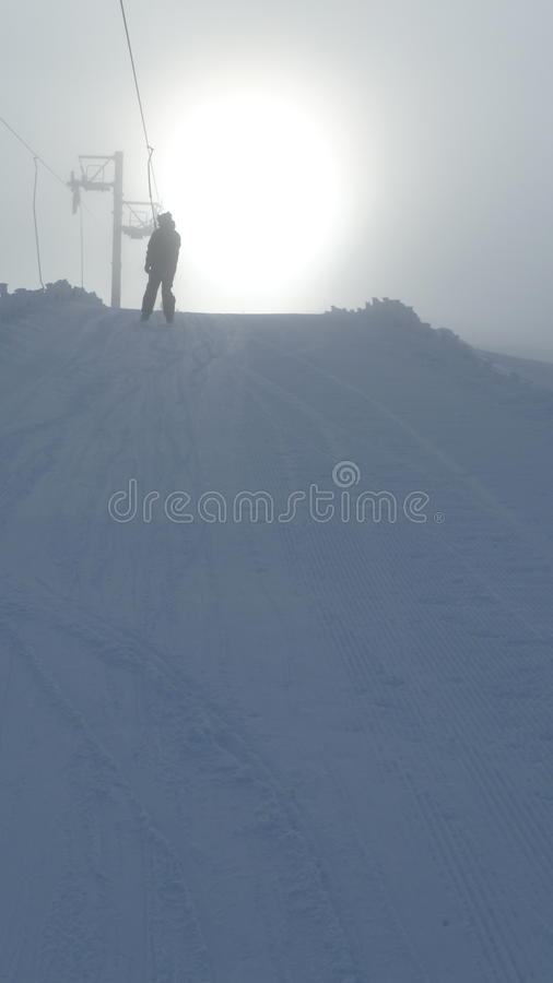 Skiing into the sun royalty free stock photos