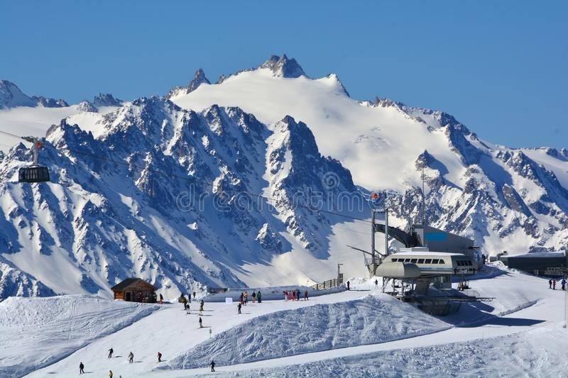 Skiing in Verbier. In the area of the Lac des Vaux, with the Aiguille du Tour in the background. The Attelas cable car station with access to the Mont Gele royalty free stock photos
