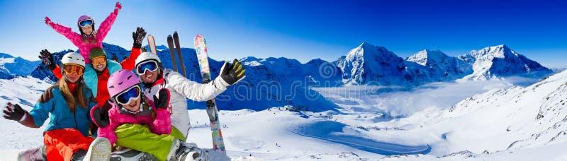Skiing, winter fun. Happy skiers, family team