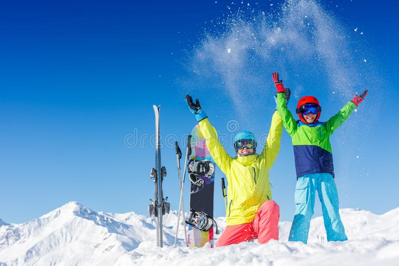 Skiing, winter, snow, sun and fun - kids, boy and girl having fun in the Alps. Child skiing in the mountains. royalty free stock photos