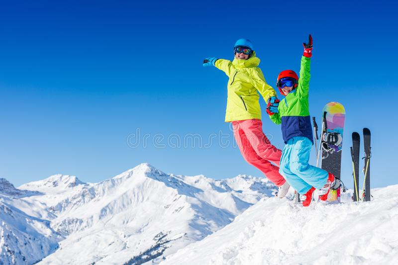 Skiing, winter, snow, sun and fun - kids, boy and girl jumping and having fun in the Alps. Child skiing in the mountains royalty free stock images