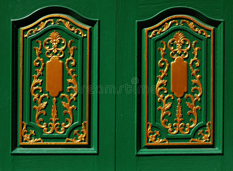 Skilfully crafted green shutters. With golden ornament royalty free stock photos