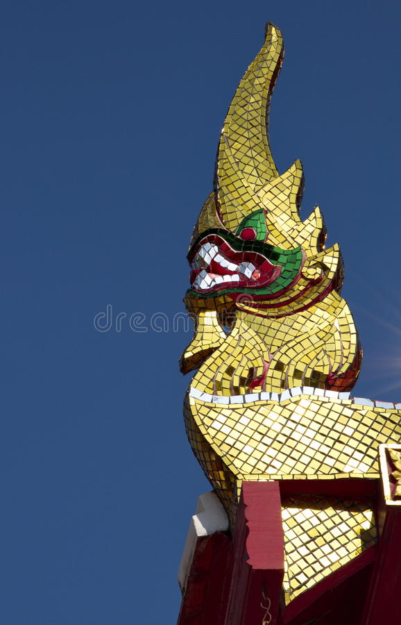 Skilfully crafted Naga head. Skilfully crafted lower finials at Buddhist temple in Thailand royalty free stock images