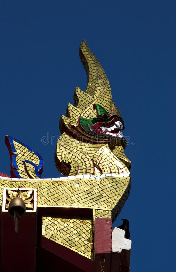 Skilfully crafted Naga head. Skilfully crafted lower finials at Buddhist temple in Thailand stock photography