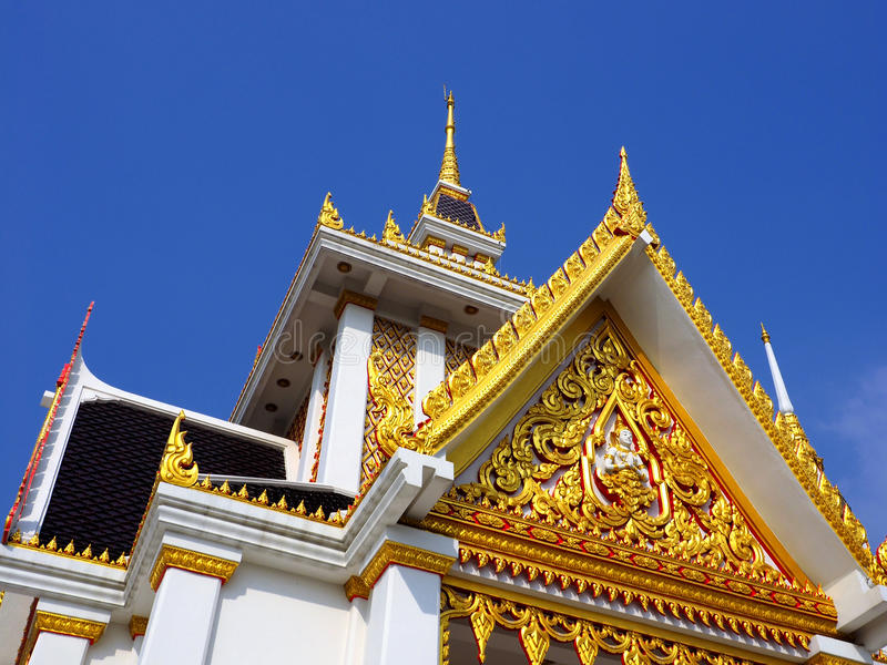Skilfully crafted pavilion at Thai temple. Skilfully crafted pavilion soaring into blue sky at Wat Ku, an iconic Buddhist temple in Nonthaburi province of royalty free stock images
