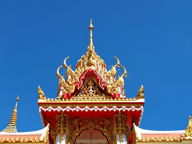 Skilfully crafted pavilion at Thai temple. Skilfully crafted pavilion soars into blue sky at Buddhist temple in Thailand stock photo