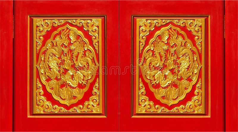 Skilfully crafted red and golden panels. Close-up of skilfully crafted red and golden front door panels stock photography