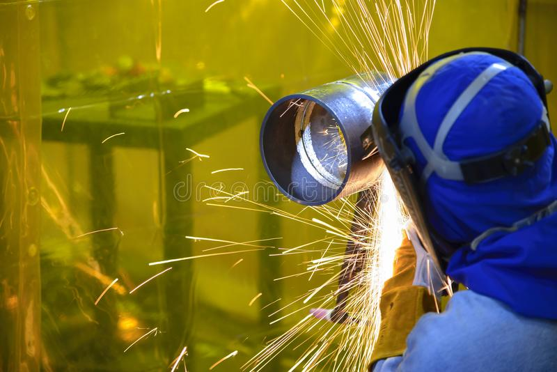 The skill worker use hand grinder machine royalty free stock photos