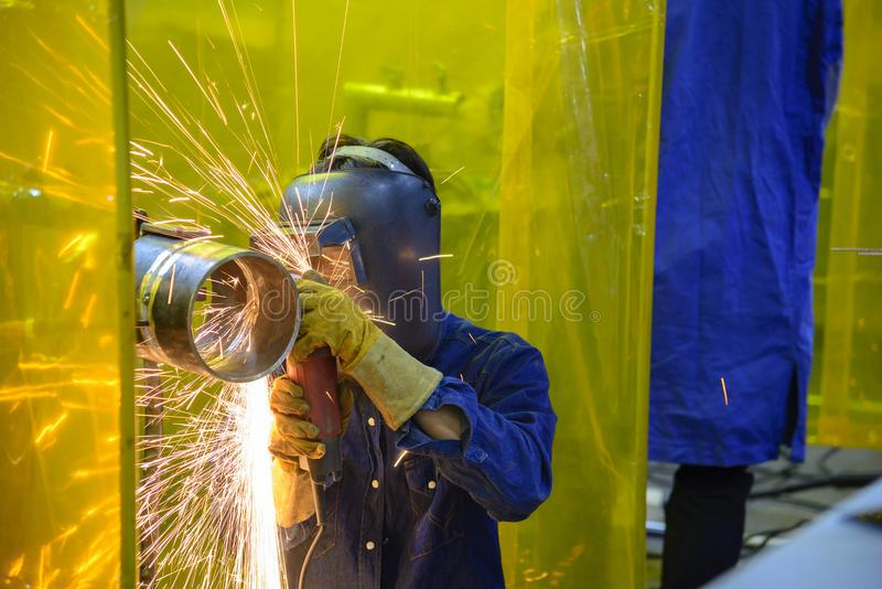 The skill worker use hand grinder machine royalty free stock photography