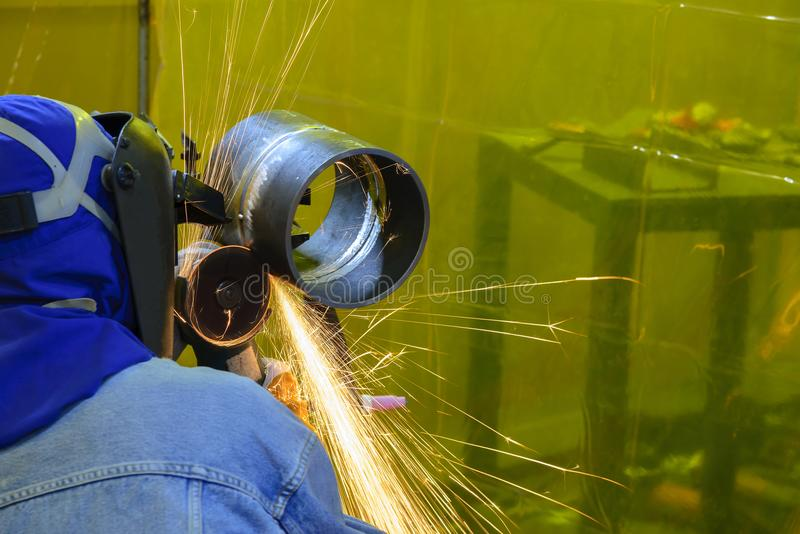 The skill worker use hand grinding machine stock photo