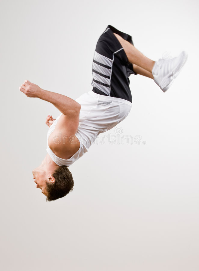 Download Skilled Athlete Doing Somersault In Mid-air Stock Photo - Image: 6601186