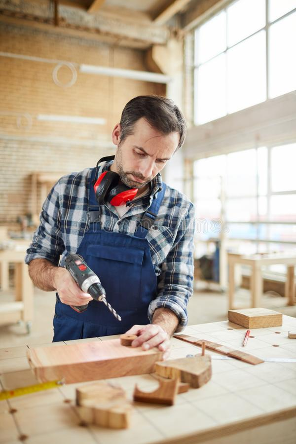 Skilled carpenter Making Wooden Toys stock photos
