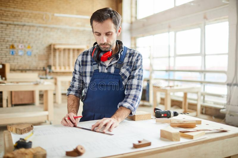 Skilled carpenter Planning Project stock photography