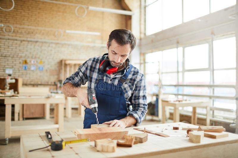 Skilled Carpenter in Workshop stock images