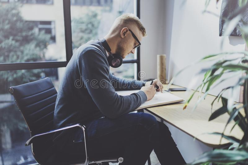Skilled designer caucasian man drawing abstract sketch with pen.Art work process.Creative hobby.Noting ideas in copy royalty free stock photo