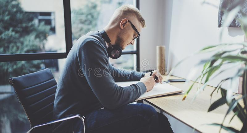 Skilled designer caucasian man drawing abstract sketch with pen.Art work process.Creative hobby.Noting ideas in copy stock images