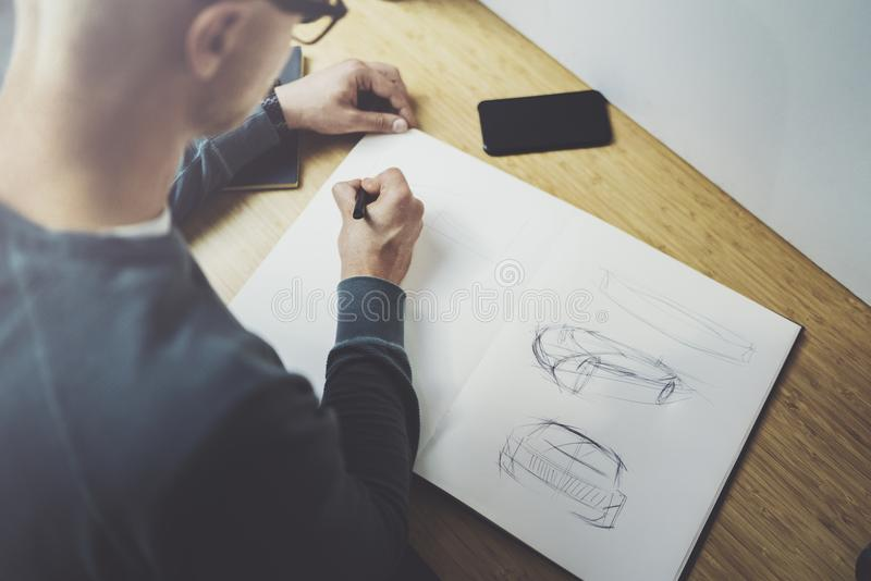 Skilled designer caucasian man drawing abstract sketch with pen.Art work process.Creative hobby.Noting ideas in copy royalty free stock photos