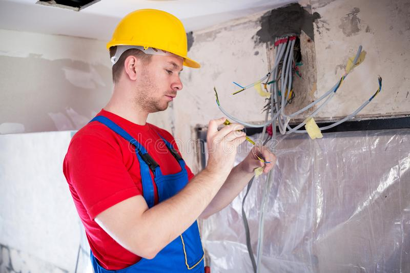 Skilled operative performing voltage checking stock images
