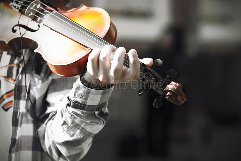 A skilled violinist plays a melody on an old beautiful violin royalty free stock photos