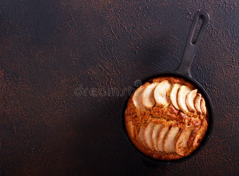 Skillet apple cake,. On dark background royalty free stock photo