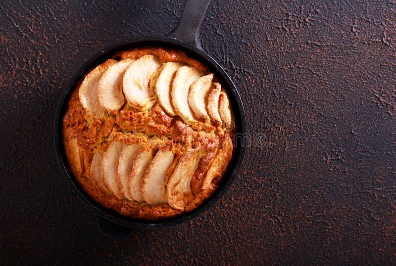 Skillet apple cake. On dark background royalty free stock photos