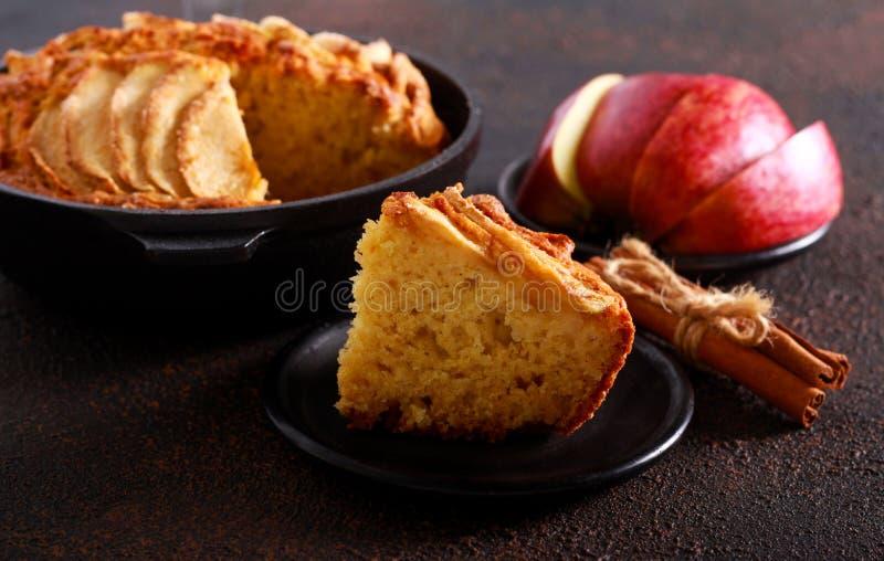 Skillet apple cake. Served on dark background stock images