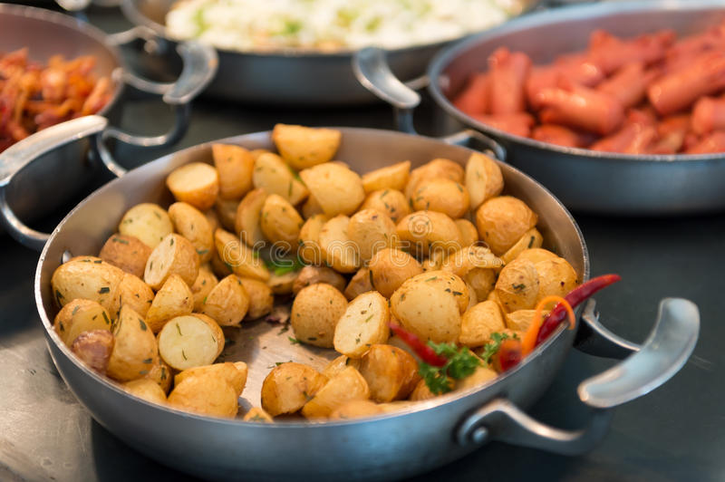 Skillet with saute potatoes. In a breakfast buffet stock photos