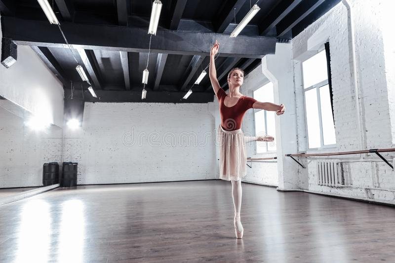 Skillful beautiful ballet dancer having a rehearsal. Before the performance. Skillful beautiful ballet dancer having a rehearsal while preparing for the stock images