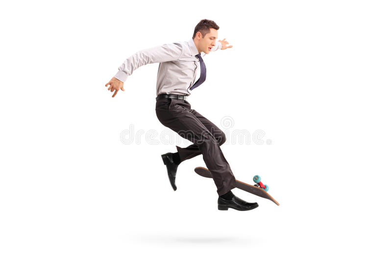 Skillful businessman performing trick on skateboard stock photos