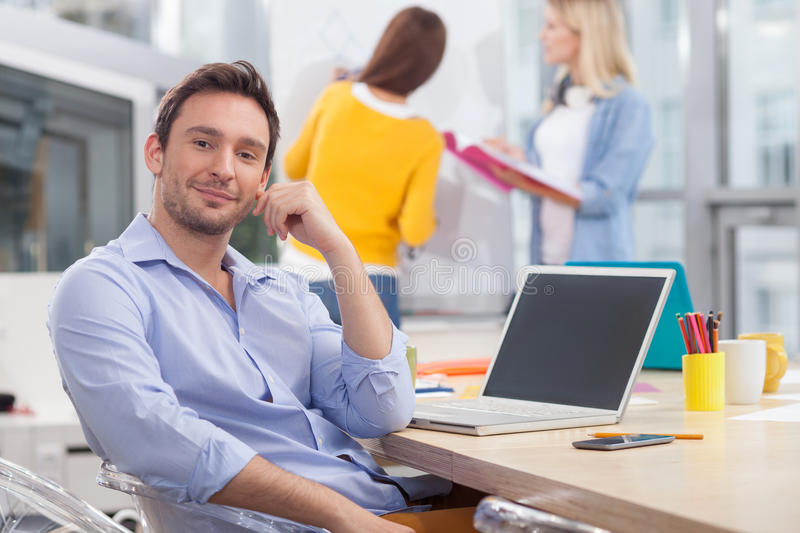 Skillful young designers are discussing their work royalty free stock photos