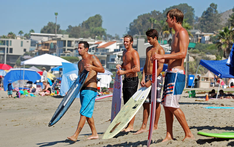 Skim Boarders wait for a wave to ride at Aliso Beach in Laguna Beach, California. Image shows skim boarders waiting for a shore break wave to ride at Aliso royalty free stock photos