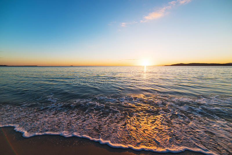 Skim on the foreshore. At sunset in Alghero stock photography